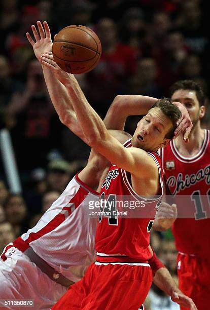 Mike Dunleavy of the Chicago Bulls is hit by Jonas Valanciunas of the Toronto Raptors at the United Center on February 19 2016 in Chicago Illinois...