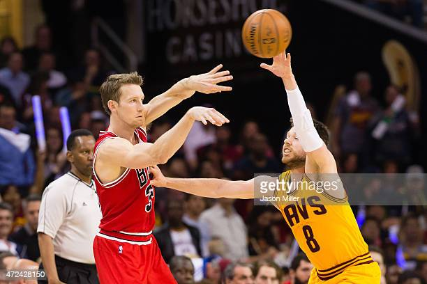 Mike Dunleavy of the Chicago Bulls passes around Matthew Dellavedova of the Cleveland Cavaliers in the first half during Game Two in the Eastern...
