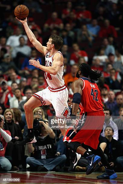 Mike Dunleavy of the Chicago Bulls puts up a shot past Nene of the Washington Wizards in Game Five of the Eastern Conference Quarterfinals during the...