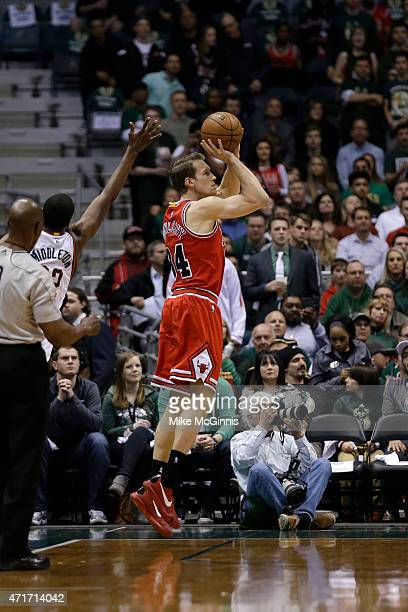 Mike Dunleavy of the Chicago Bulls shoots a three pointer in the first quarter against the Milwaukee Bucks during the first round of the 2015 NBA...