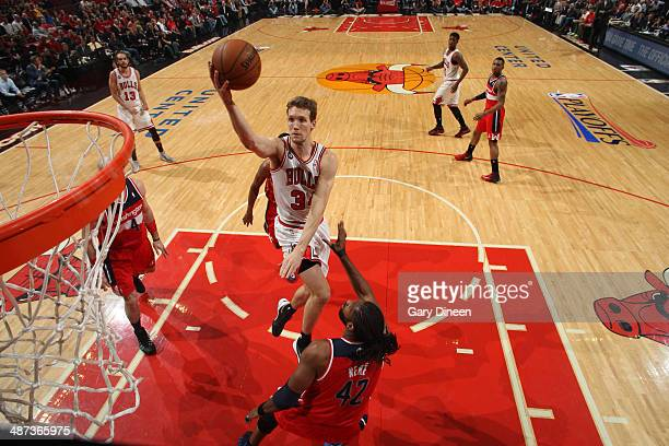 Mike Dunleavy of the Chicago Bulls shoots against Nene of the Washington Wizards in Game 5 of the Eastern Conference Quarterfinals in the 2014 NBA...