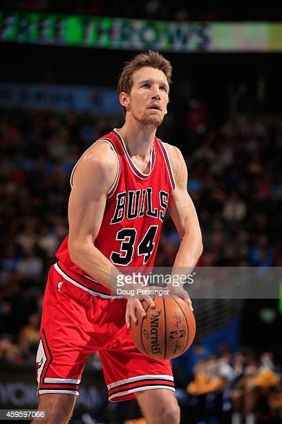 Mike Dunleavy of the Chicago Bulls takes a free throw against the Denver Nuggets at Pepsi Center on November 25 2014 in Denver Colorado The Nuggets...