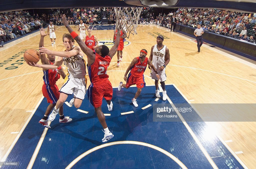 Mike Dunleavy #17 of the Indiana Pacers lays the ball up against Antonio McDyess #24 of the Detroit Pistons during the game at Conseco Fieldhouse on April 3, 2007 in Indianapolis, Indiana. The Pistons won 100-85.