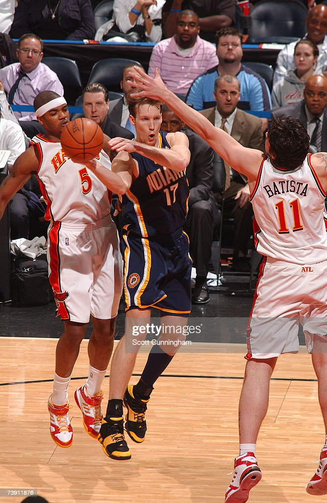 Mike Dunleavy of the Indiana Pacers passes against Esteban Batista and Josh Smith of the Atlanta Hawks on April 17 2007 at Philips Arena in Atlanta...