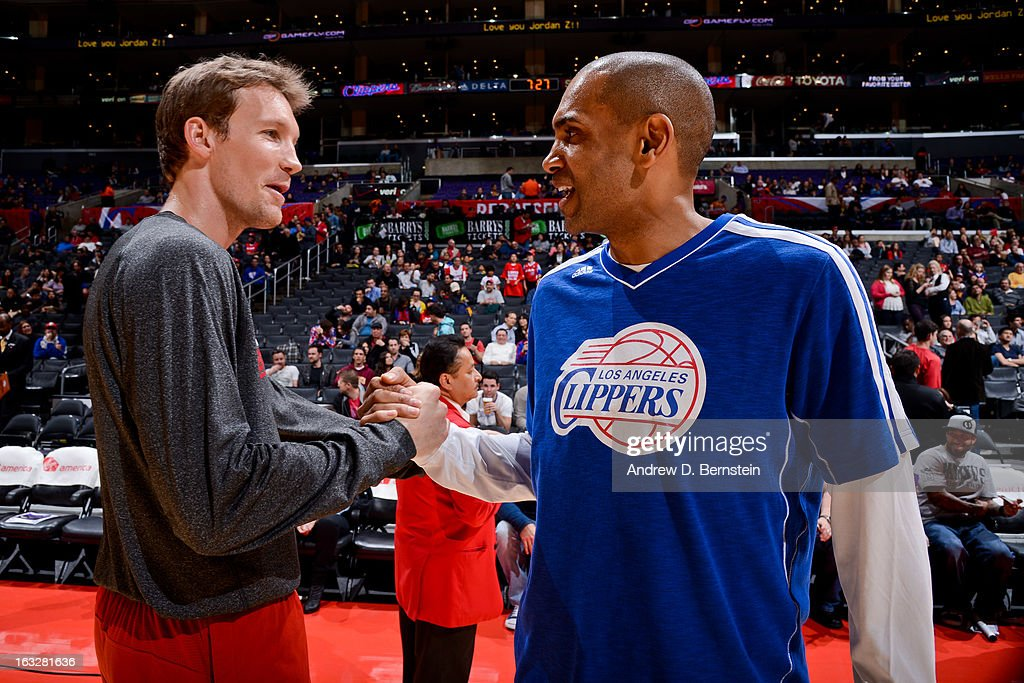 Mike Dunleavy #17 of the Milwaukee Bucks greets Grant Hill #33 of the Los Angeles Clippers before their game at Staples Center on March 6, 2013 in Los Angeles, California.