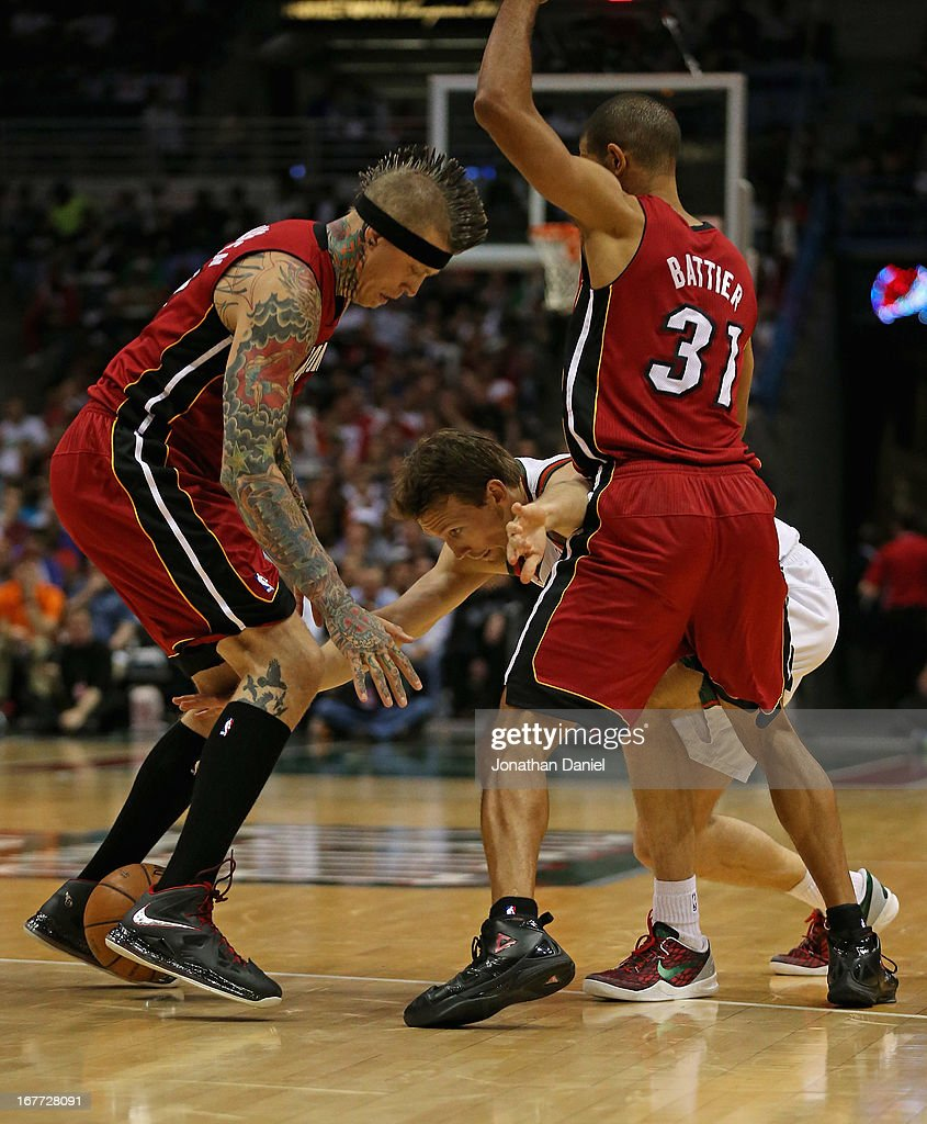 Mike Dunleavy #17 of the Milwaukee Bucks looses control of the ball between Chris Anderson #11 and <a gi-track='captionPersonalityLinkClicked' href=/galleries/search?phrase=Shane+Battier&family=editorial&specificpeople=201814 ng-click='$event.stopPropagation()'>Shane Battier</a> #31 of the Miami Heat in Game Four of the Eastern Conference Quarterfinals during the 2013 NBA Playoffs at the Bradley Center on April 28, 2013 in Milwaukee, Wisconsin. The Heat defeated the Bucks 88-77.