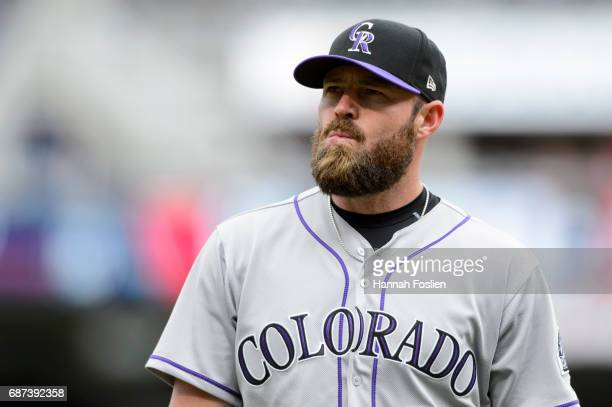 Mike Dunn of the Colorado Rockies looks on during game one of a doubleheader against the Minnesota Twins on May 18 2017 at Target Field in...