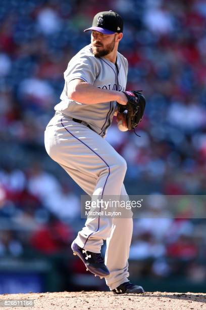 Mike Dunn of the Colorado Rockies pitches during game one of a doubleheader baseball game against the Washington Nationals at Nationals Park on July...