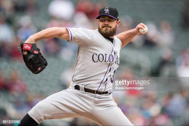 Mike Dunn of the Colorado Rockies pitches during game one of a doubleheader against the Minnesota Twins on May 18 2017 at Target Field in Minneapolis...