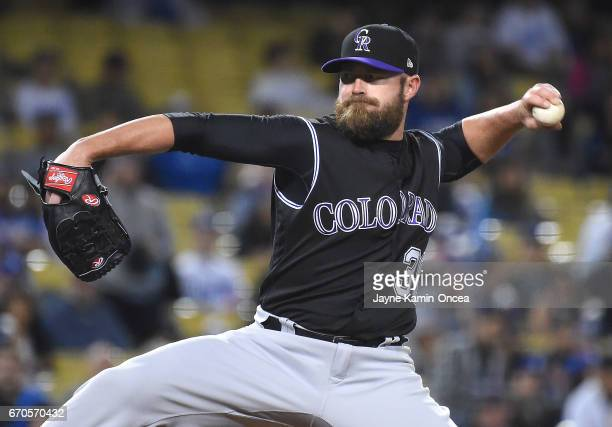 Mike Dunn of the Colorado Rockies pitches during the game against the Los Angeles Dodgers at Dodger Stadium on April 18 2017 in Los Angeles California