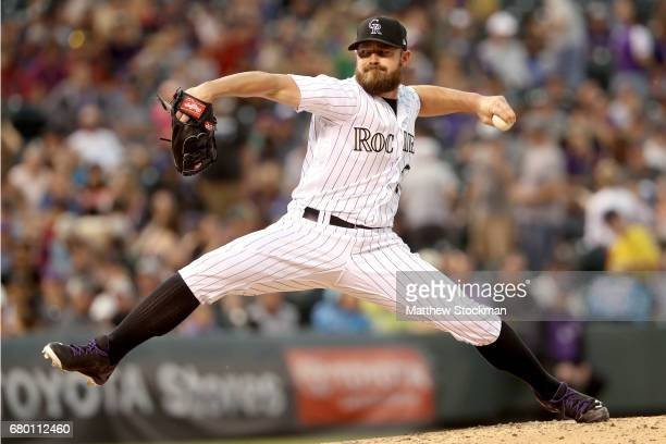 Mike Dunn of the Colorado Rockies pitches in the eighth inning against the Arizona Diamondbacks at Coors Field on May 7 2017 in Denver Colorado