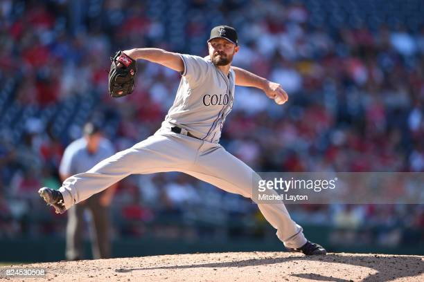 Mike Dunn of the Colorado Rockies pitches in the seventh inning during game one of a doubleheader baseball game against the Washington Nationals at...