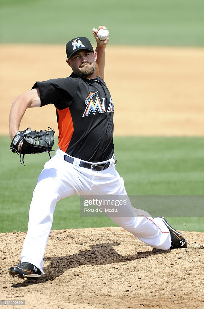 Mike Dunn #40 of the Miami Marlins pitches during a spring training game against the Washington Nationals at Roger Dean Stadium on March 26, 3012 in Jupiter, Florida.