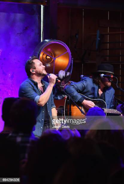 Mike Eli and James Young of the Eli Young band perform onstage at the HGTV Lodge during CMA Music Fest on June 9 2017 in Nashville Tennessee