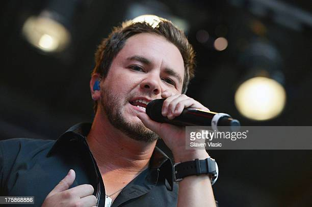 Mike Eli of Eli Young Band performs at 'FOX Friends' All American Concert Series outside of FOX Studios on August 9 2013 in New York City