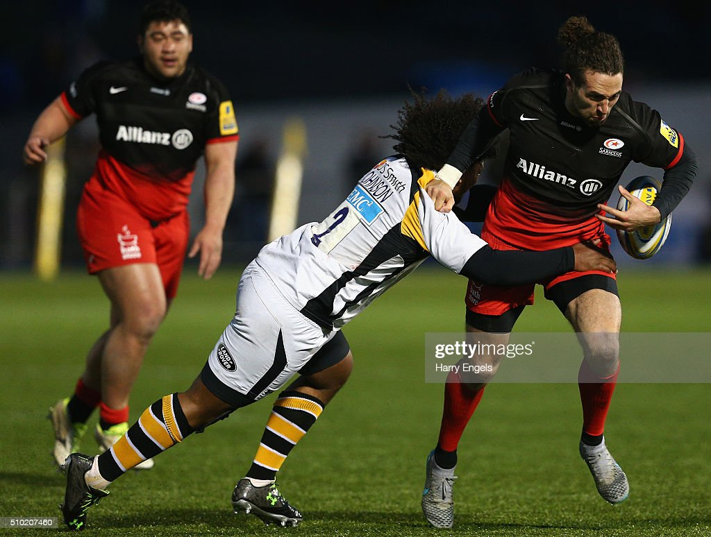 Mike Ellery of Saracens is tackled by Ashley Johnson of Wasps during the Aviva Premiership match between Saracens and Wasps at Allianz Park on February 14, 2016 in London, United Kingdom.