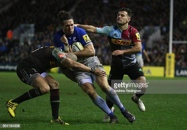 Mike Ellery of Saracens is tackled by Mike Brown and Danny Care of Harlequins during the Aviva Premiership match between Harlequins and Saracens at...