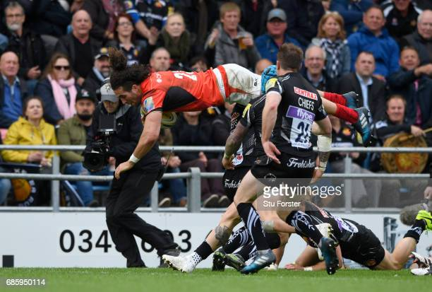 Mike Ellery of Saracens is upended by Ian Whitten of Exeter Chiefs as he scores his team'ssecond try during the Aviva Premiership semi final match...