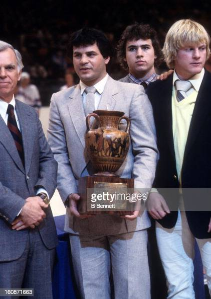 Mike Eruzione and Bob Suter of the 1980 Team USA Olympic Hockey team accept an award during a New York Rangers game in December 1980 at the Madison...