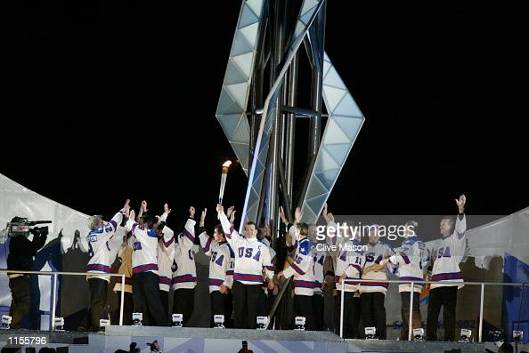 Mike Eruzione captain of the 1980 'Miracle on Ice' US Hockey Team and the rest of the gold medal hockey squad prepare to light the Olympic Cauldron...