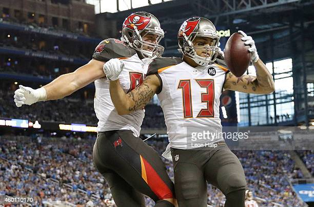 Mike Evans celebrates his fourth quarter touchdown with Luke Stocker of the Tampa Bay Buccaneers while playing the Detroit Lions at Ford Field on...