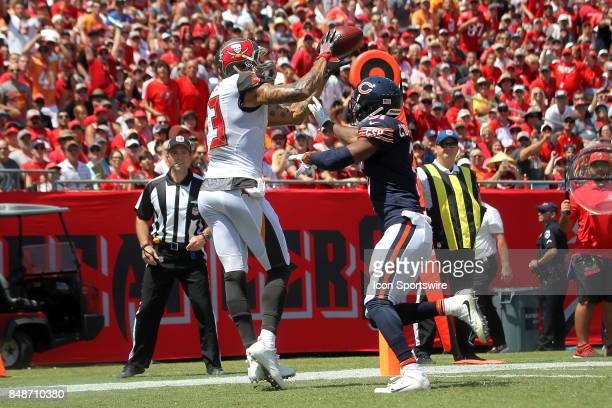 Mike Evans of the Buccaneers taps his toes as he catches the Jameis Winston pass for a touchdown as Marcus Cooper Sr of the Bears defends during the...