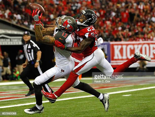 Mike Evans of the Tampa Bay Buccaneers pulls in this touchdown reception against Robert Alford of the Atlanta Falcons at Georgia Dome on September 11...