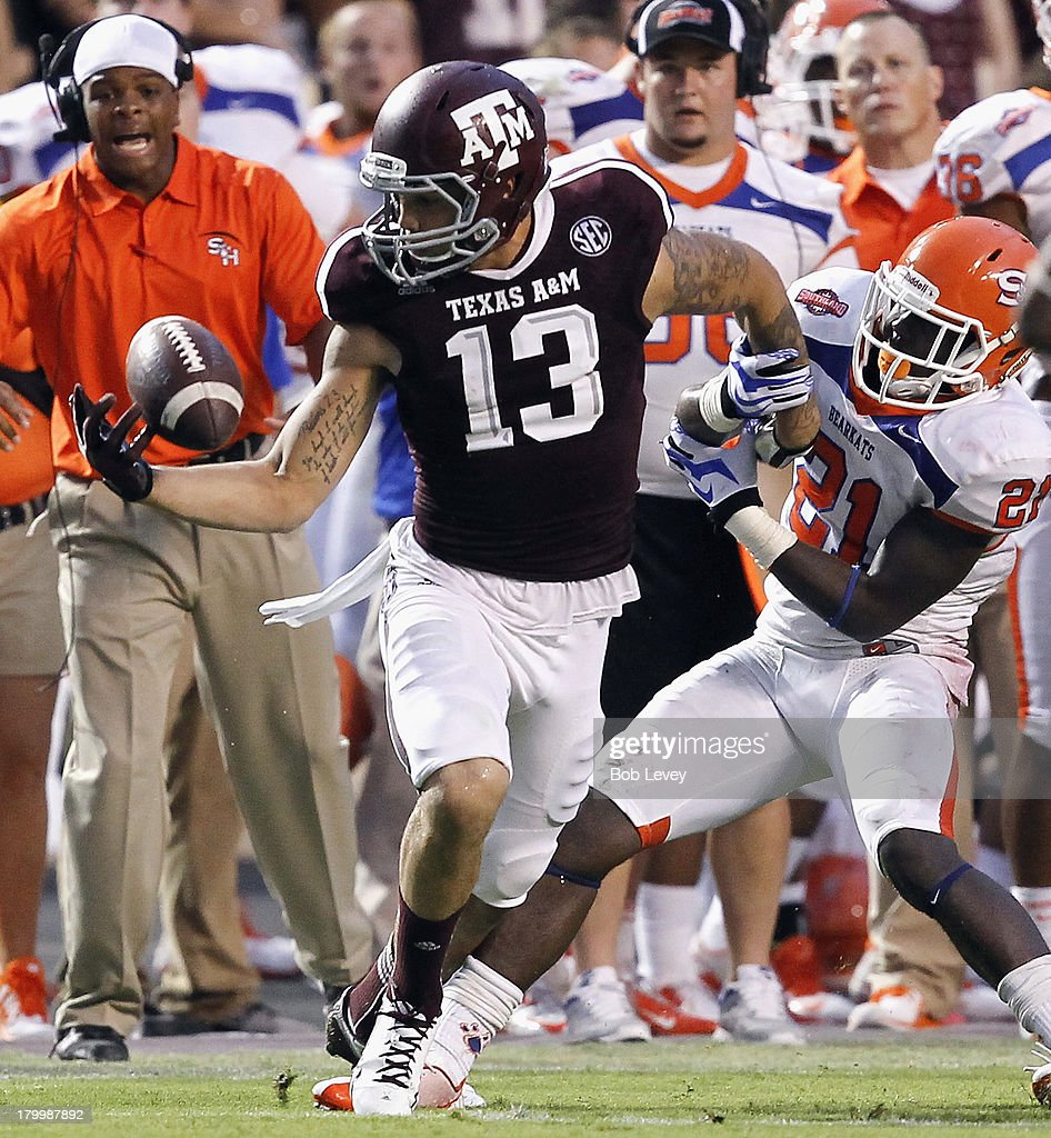 Mike Evans #13 of the Texas A&M Aggies juggles but gains control of the ball as he is defended by Desmond Fite #21 of the Sam Houston State Bearkats in the second quarter at Kyle Field on September 7, 2013 in College Station, Texas.