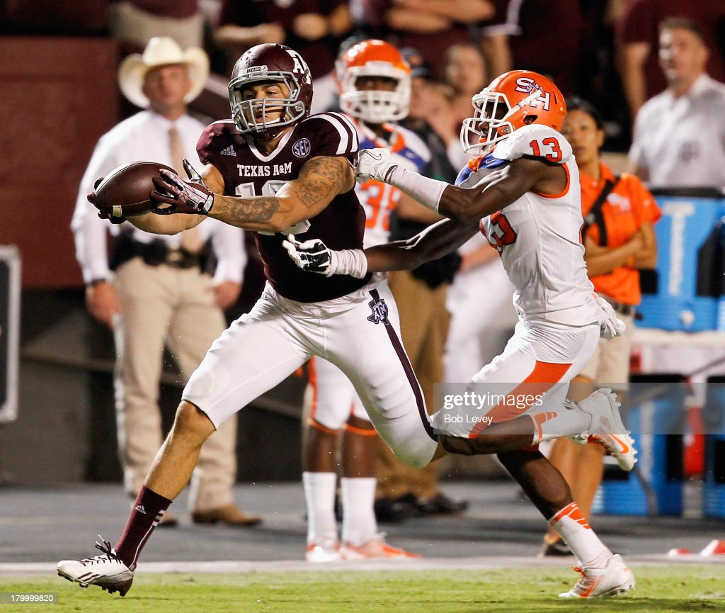 Mike Evans #13 of the Texas A&M Aggies makes a catch as he beats DeAntrey Loche #13 of the Sam Houston State Bearkats at Kyle Field on September 7, 2013 in College Station, Texas.