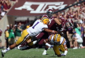 Mike Evans of the Texas AM Aggies runs the ball against Eric Reid and Jalen Collins of the LSU Tigers at Kyle Field on October 20 2012 in College...
