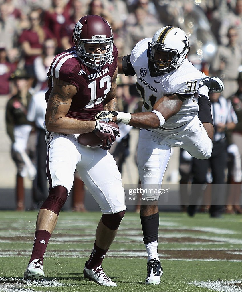 Mike Evans #13 of the Texas A&M Aggies scores as he beats Javon Marshall #31 of the Vanderbilt Commodores to the ball in the third quarter at Kyle Field on October 26, 2013 in College Station, Texas.