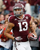Mike Evans of the Texas AM Aggies works out on the field before the game against the Mississippi State Bulldogs at Kyle Field on November 9 2013 in...