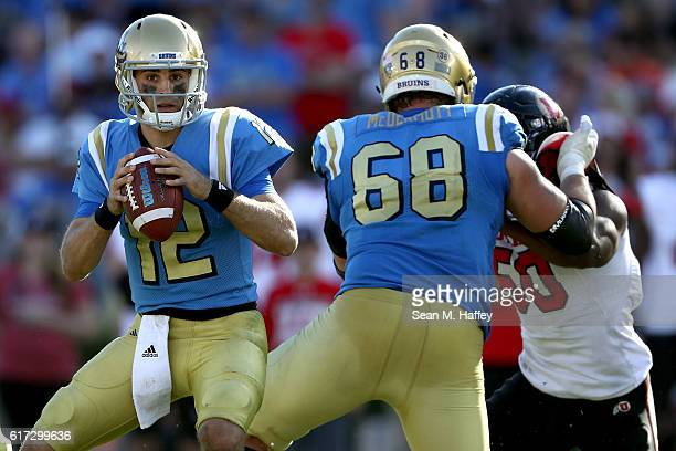 Mike Fafaul looks to pass as Conor McDermott of the UCLA Bruins blocks Pita Taumoepenu of the Utah Utes during the second half of a game at the Rose...