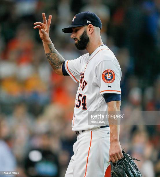 Mike Fiers of the Houston Astros acknowledges the rowd as he leaves the game in the eighth inning against the Los Angeles Angels of Anaheim at Minute...