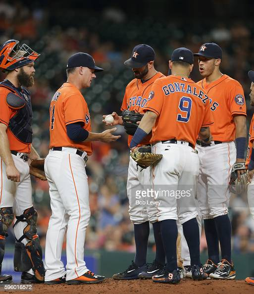 Mike Fiers of the Houston Astros hands the ball to manager AJ Hinch of the Houston Astros as he leaves the game in the seventh inning against the...