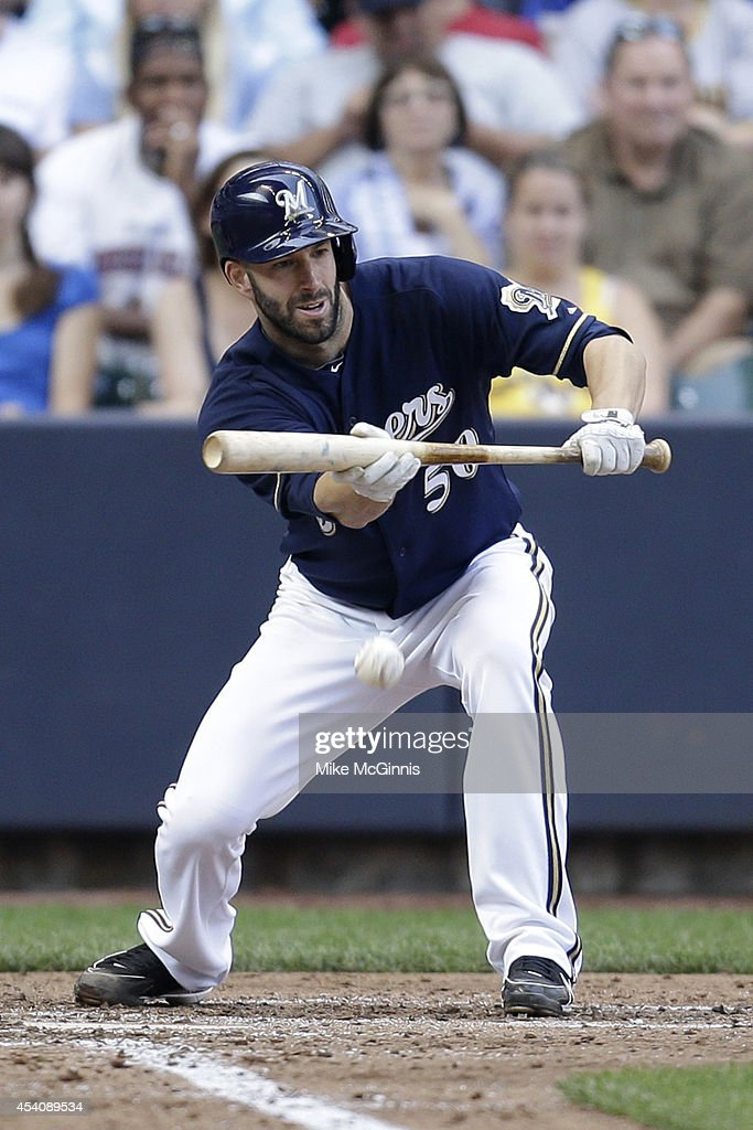 <a gi-track='captionPersonalityLinkClicked' href=/galleries/search?phrase=Mike+Fiers&family=editorial&specificpeople=8948526 ng-click='$event.stopPropagation()'>Mike Fiers</a> #50 of the Milwaukee Brewers lays down a sacrifice bunt advancing Gerardo Parra in the bottom of the sixth inning against the Pittsburgh Pirates at Miller Park on August 24, 2014 in Milwaukee, Wisconsin.