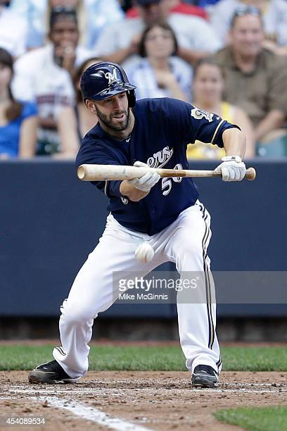 Mike Fiers of the Milwaukee Brewers lays down a sacrifice bunt advancing Gerardo Parra in the bottom of the sixth inning against the Pittsburgh...