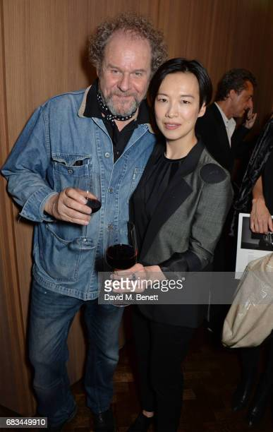 Mike Figgis and Rosey Chan attend '8 Years Of My Life' an intimate evening of music with Rosey Chan hosted by Rosey Chan and Client Earth at Cafe...