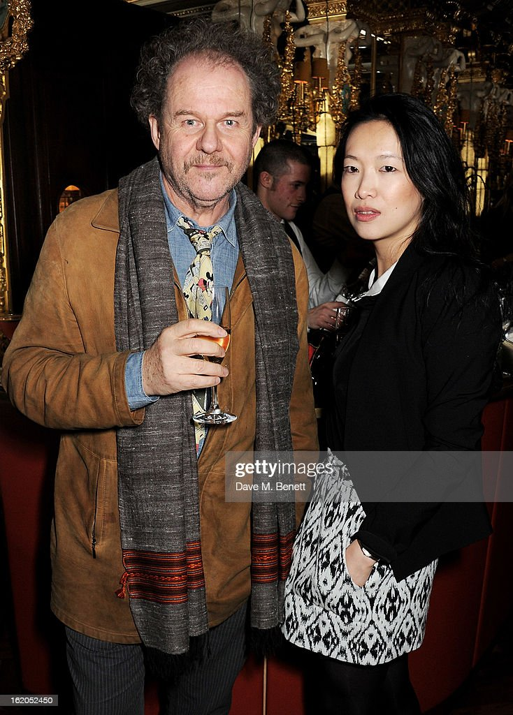 Mike Figgis (L) and Rosey Chan attend the AnOther Magazine and Dazed & Confused party with Belvedere Vodka at the Cafe Royal hotel on February 18, 2013 in London, England.
