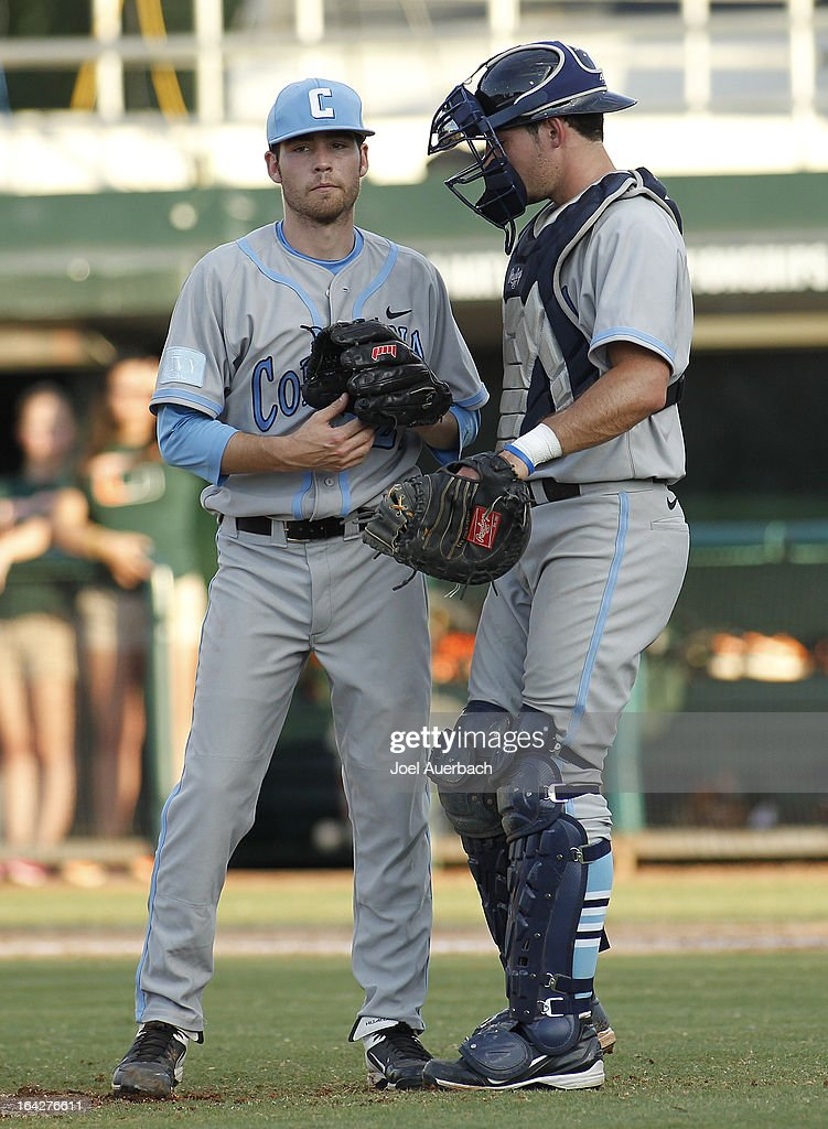 Mike Fischer #4 talks to Kevin Roy #22 of the Columbia Lions after he gave up two doubles against the Miami Hurricanes on March 19, 2013 at Alex Rodriguez Park at Mark Light Field in Coral Gables, Florida. Miami defeated Columbia 9-6.