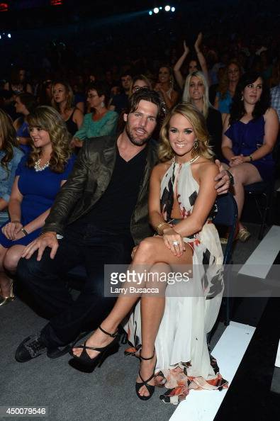 Mike Fisher and Carrie Underwood attend the 2014 CMT Music awards at the Bridgestone Arena on June 4 2014 in Nashville Tennessee