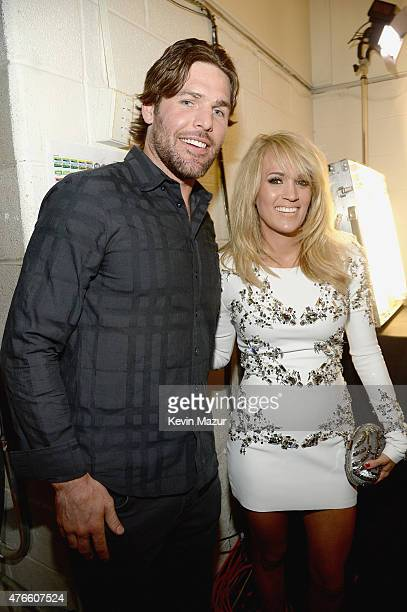 Mike Fisher and Carrie Underwood attend the 2015 CMT Music awards at the Bridgestone Arena on June 10 2015 in Nashville Tennessee