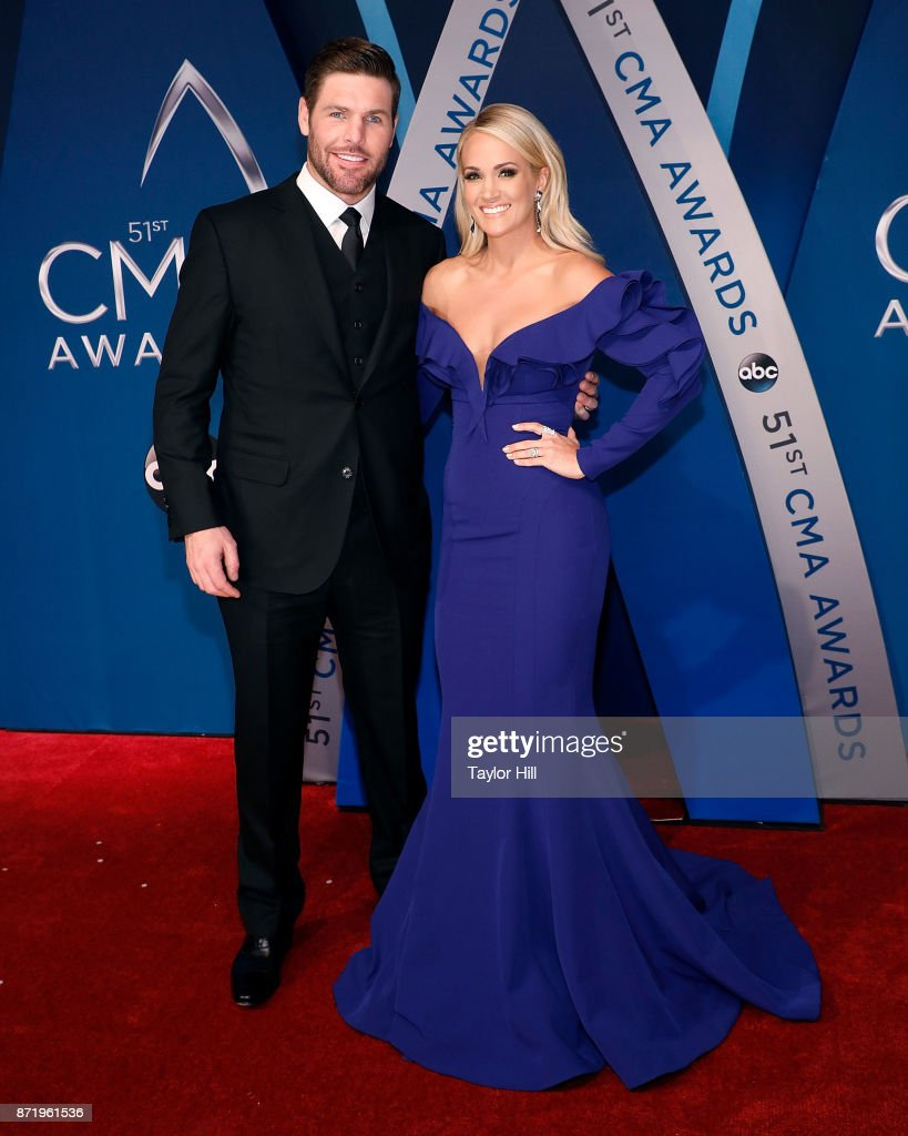 Mike Fisher and Carrie Underwood attend the 51st annual CMA Awards at the Bridgestone Arena on November 8, 2017 in Nashville, Tennessee.