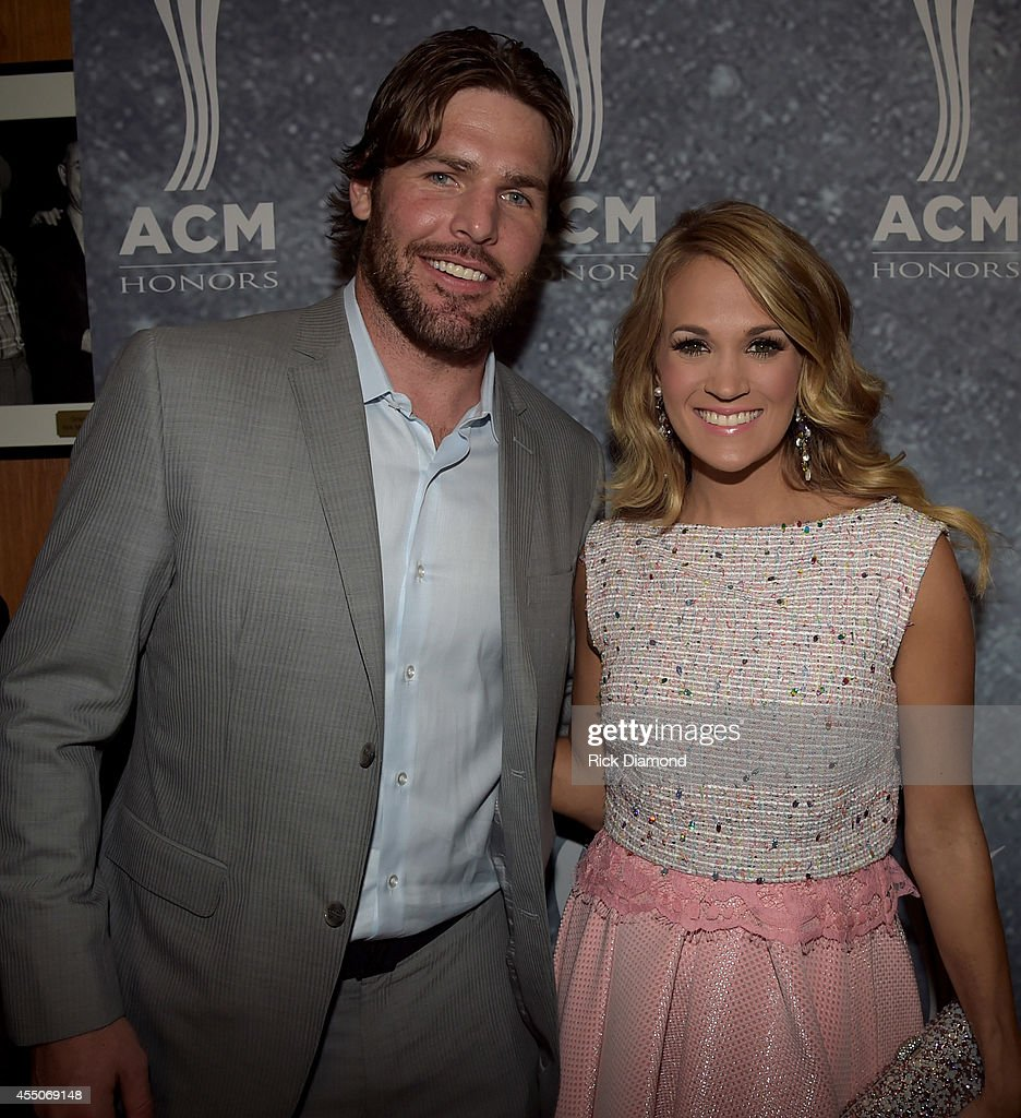 <a gi-track='captionPersonalityLinkClicked' href=/galleries/search?phrase=Mike+Fisher&family=editorial&specificpeople=204732 ng-click='$event.stopPropagation()'>Mike Fisher</a> and <a gi-track='captionPersonalityLinkClicked' href=/galleries/search?phrase=Carrie+Underwood&family=editorial&specificpeople=204483 ng-click='$event.stopPropagation()'>Carrie Underwood</a> attend the 8th Annual ACM Honors at Ryman Auditorium on September 9, 2014 in Nashville, Tennessee.
