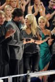 Mike Fisher and Carrie Underwood performs onstage at the 2010 CMT Music Awards at the Bridgestone Arena on June 9 2010 in Nashville Tennessee