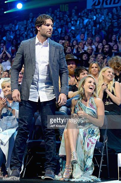 Mike Fisher Carrie Underwood and Kelsea Ballerini attend the 2016 CMT Music awards at the Bridgestone Arena on June 8 2016 in Nashville Tennessee