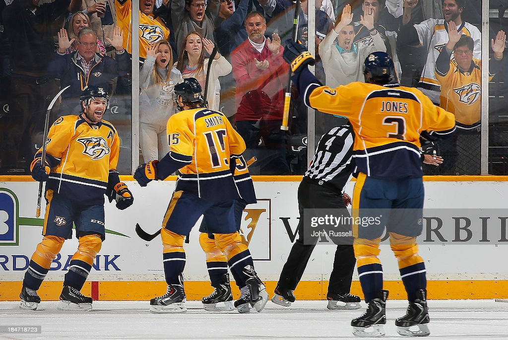 Mike Fisher #12 celebrates his goal with Craig Smith #15 of the Nashville Predators against the Florida Panthers at Bridgestone Arena on October 15, 2013 in Nashville, Tennessee.