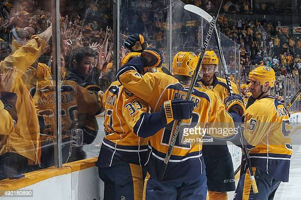 Mike Fisher Colin Wilson Seth Jones and Barret Jackman of the Nashville Predators celebrate a goal against Edmonton Oilers during an NHL game at...