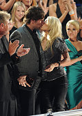 Mike Fisher kisses Carrie Underwood after she wins an award at the 2010 CMT Music Awards at the Bridgestone Arena on June 9 2010 in Nashville...
