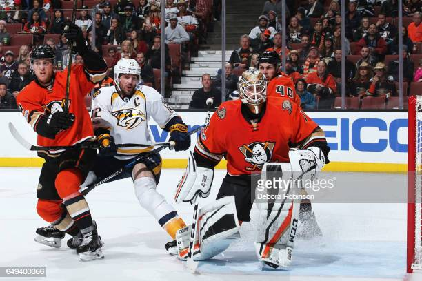Mike Fisher of the Nashville Predators battles for position against Cam Fowler and Jonathan Bernier of the Anaheim Ducks during the game on March 7...